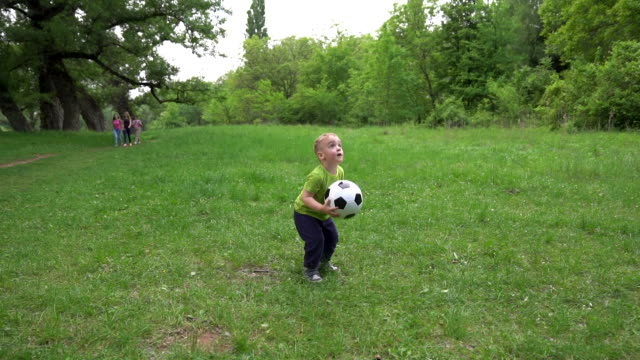 slow motion little boy playing soccer - throwing stock videos & royalty-free footage