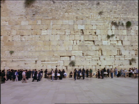 slow motion long shot people praying at Wailing Wall (Western Wall) / Jerusalem, Israel