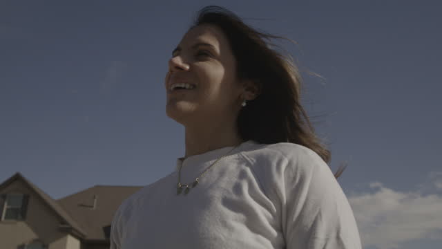 slow motion low angle close up of smiling woman removing protective mask / lehi, utah, united states - lehi stock videos & royalty-free footage