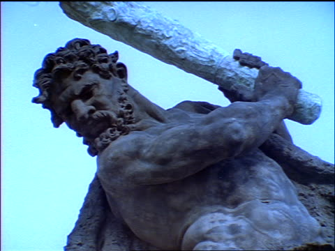 blue slow motion low angle close up tilt up statue of man with club at prague castle / czech republic - männliche figur stock-videos und b-roll-filmmaterial