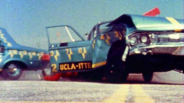1968 slow motion low angle two cars crashing into each other + test dummies falling out during crash test - crash test stock videos & royalty-free footage