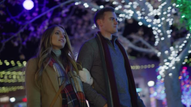 vidéos et rushes de slow motion low angle view of couple walking outdoors during christmas / provo, utah, united states - provo