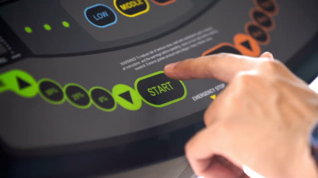 Slow Motion - Male Hand Click Start on a Treadmill