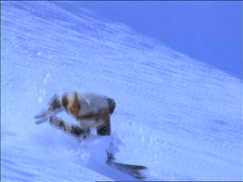 slow motion male snowboarder tumbling down slope - moving down stock videos & royalty-free footage