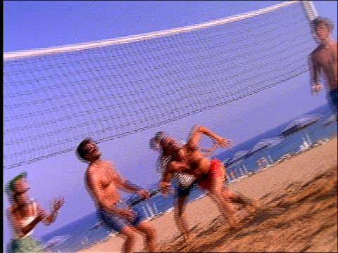 slow motion man diving for volleyball + wiping out - falla av bildbanksvideor och videomaterial från bakom kulisserna