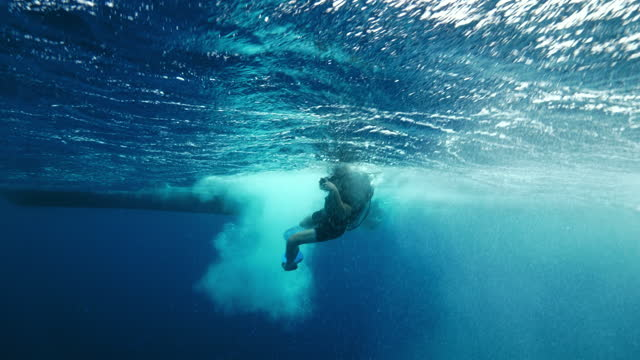 slow motion: man scuba diving in blue sea - belize city, belize - aqualung diving equipment stock videos & royalty-free footage