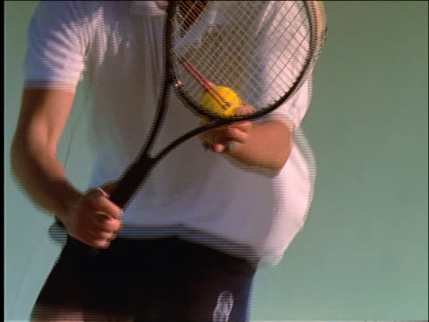 slow motion man serving ball in tennis match - serving sport stock videos and b-roll footage