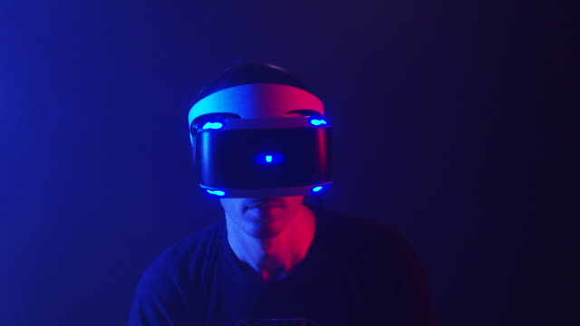 Slow motion, man uses virtual reality headset, games, technology