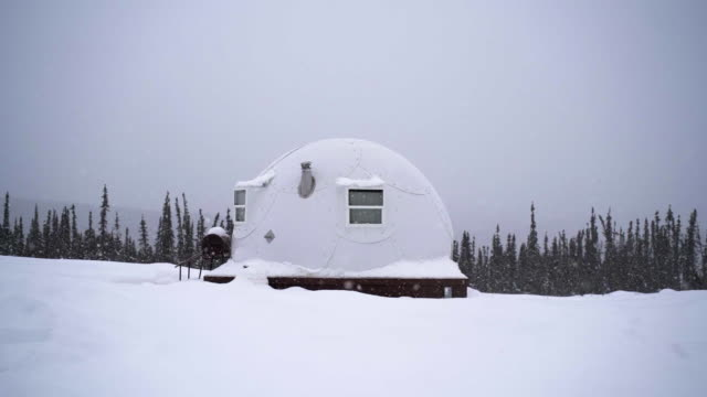 slow motion: manufactured igloo and while it snows in alaska, fairbanks, alaska - igloo stock videos & royalty-free footage