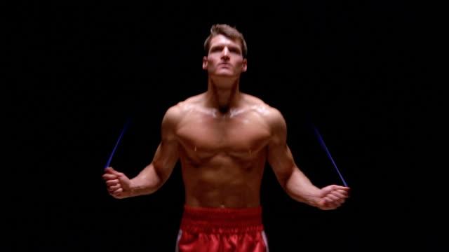 Slow motion medium shot boxer skipping rope / London