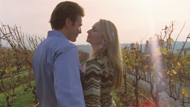 Slow motion medium shot couple dancing in vineyard/ Napa Valley, California