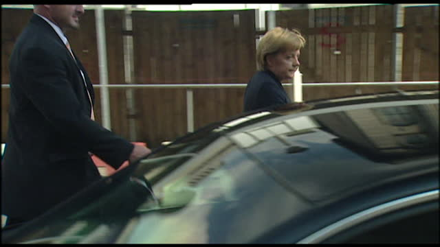 slow motion medium shot of angela merkel climbing into a black car and being driven off; 2005. - passenger seat stock videos & royalty-free footage
