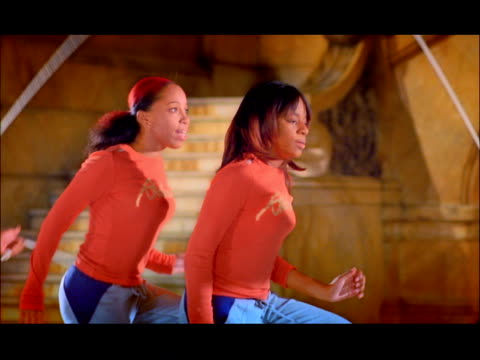 slow motion medium shot two young women doing double dutch jump roping routine - jump rope stock videos & royalty-free footage