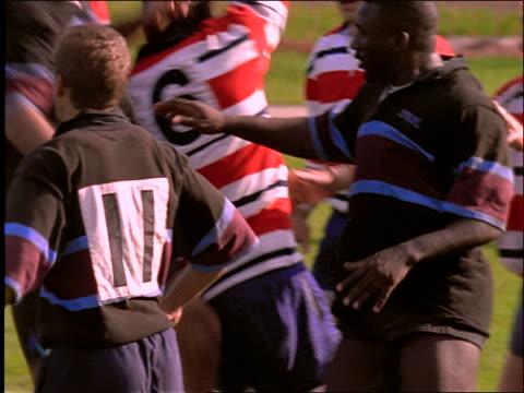 slow motion men playing rugby - スポーツ ラグビー点の映像素材/bロール