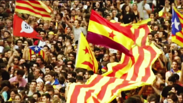 slow motion montage of proindependence supporters marching in catalonia - bbc点の映像素材/bロール