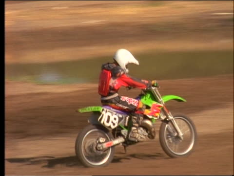 Dirt Bikes Videos >> Slow Motion Motocross Racer Riding Dirt Bike Away From
