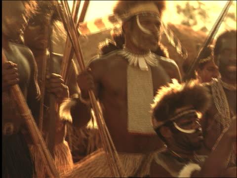 slow motion native men + boy in tribal ceremony / indonesia / dani people / wamena, irian jaya - minoranza video stock e b–roll