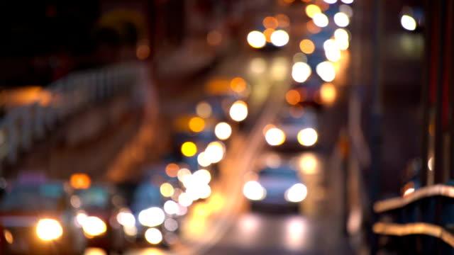 SLO MO Slow motion Night Traffic with Car Light in defocused Bokeh