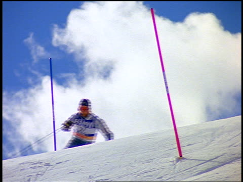 slow motion pan norwegian downhill skier (lasse kjus - world champion) skiing around poles in slalom - slalom skiing stock videos & royalty-free footage