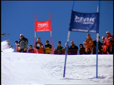 slow motion Norwegian downhill skier (Lasse Kjus - World Champion) skiing past flags in slalom / Colorado