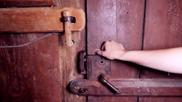 slow motion of a hand opening an ancient wooden door - antique stock videos & royalty-free footage