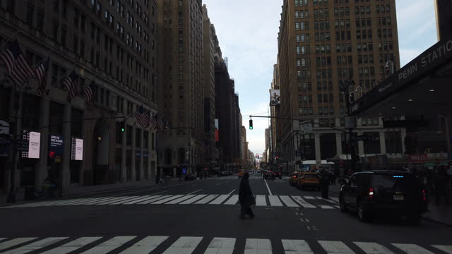 slow motion of a homeless person crossing street in the new york city in a chilly morning amid the 2020 global coronavirus pandemic. - new york city penn station stock videos & royalty-free footage