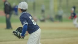 Slow motion of a kid running during a baseball game