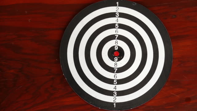 slow motion of a red dart - dart board stock videos & royalty-free footage