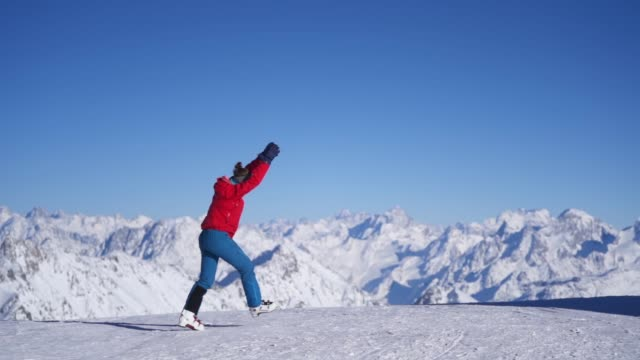 slow motion of a skier doing a cartwheel in the mountains - escapism stock videos & royalty-free footage
