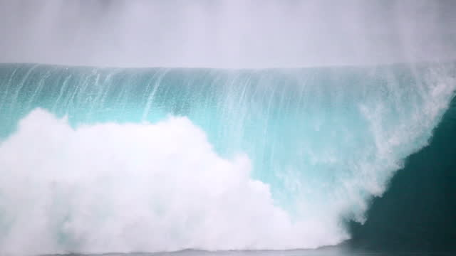 slow motion of a surfer as he wipes out and falls on a large breaking wave - oahu, hawaii - resilience stock videos & royalty-free footage