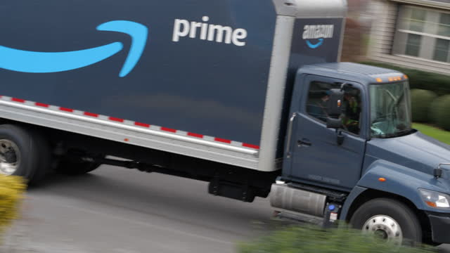 slow motion of amazon prime truck delivering in the suburban community of atlanta in the winter holiday season amid the 2020 global coronavirus... - online shopping stock videos & royalty-free footage