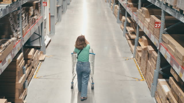 slow motion of asian woman shopping in modern warehouse - choosing stock videos & royalty-free footage