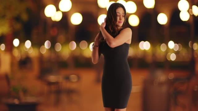 slow motion of beautiful cuban woman in tight black dress dancing sensually - black dress stock videos & royalty-free footage