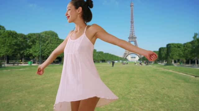 slow motion of beautiful latina woman twirling in sundress near eiffel tower - sundress stock videos & royalty-free footage