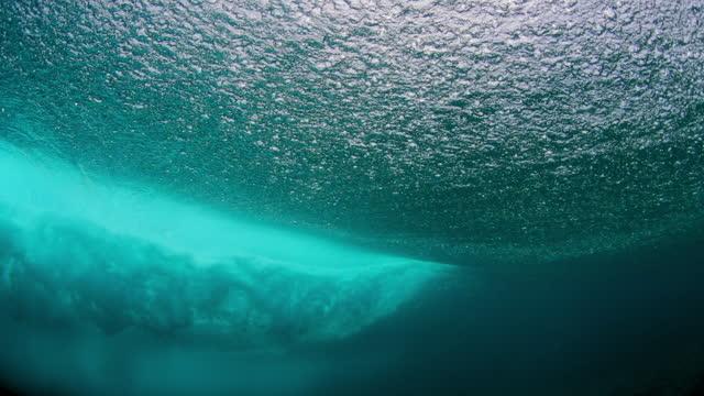 slow motion of beautiful waves splashing in ocean seen underwater - south male atoll, maldives - below stock videos & royalty-free footage