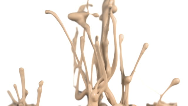 vidéos et rushes de slow motion of beige paint bouncing and splashing on white background - beige