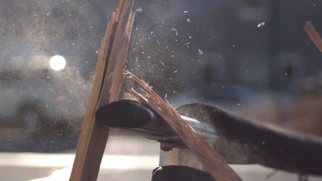 vídeos de stock, filmes e b-roll de slow motion of board breaking over metal pole. - madeira