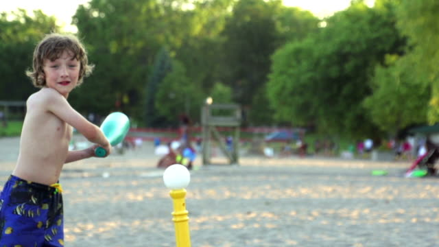 slow motion of boy playing baseball at beach - frivarv bildbanksvideor och videomaterial från bakom kulisserna