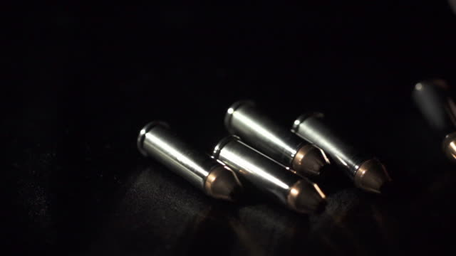 slow motion of bullet falling - medium group of objects stock videos & royalty-free footage
