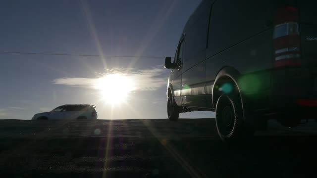 Slow motion of car driving and sunburst in the morning