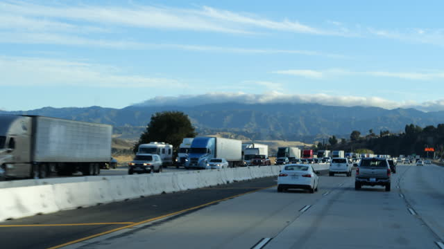 slow motion of car point of view of interstate 5 north bound traffic jam outside the city of los angeles on march 19, 2021 amid the covid-19 pandemic. - winding road stock videos & royalty-free footage