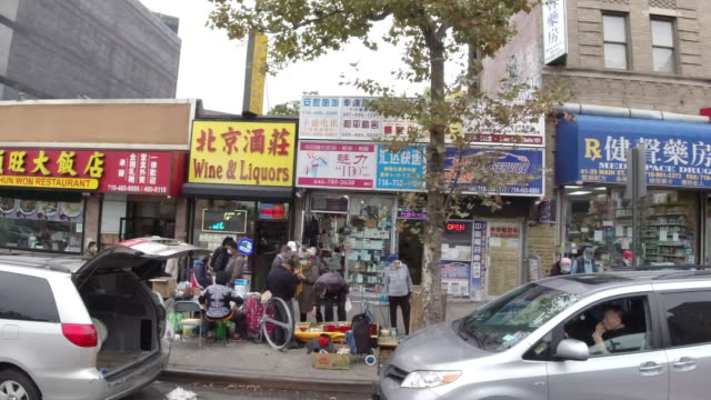 slow motion of chinese wearing face mask walking on the street in flushing chinatown, queens amid the 2020 global coronavirus pandemic, most of the... - chinatown stock videos & royalty-free footage