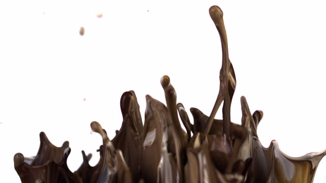 Slow Motion of chocoloate colored paint bouncing and splashing on white background