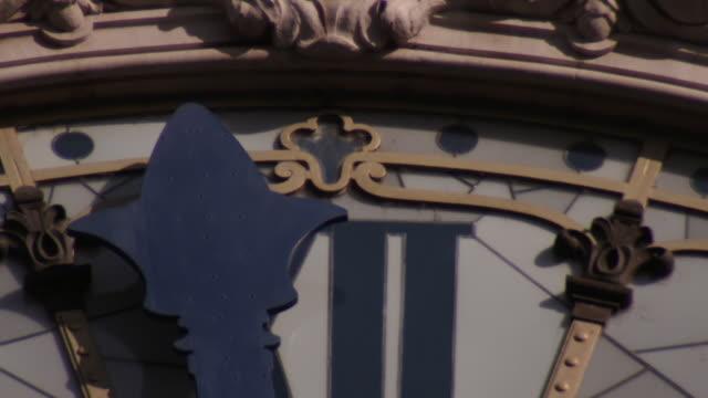 Slow motion of clock hand striking 12 on historical Paris Gare de Lyon Tower Clock Face