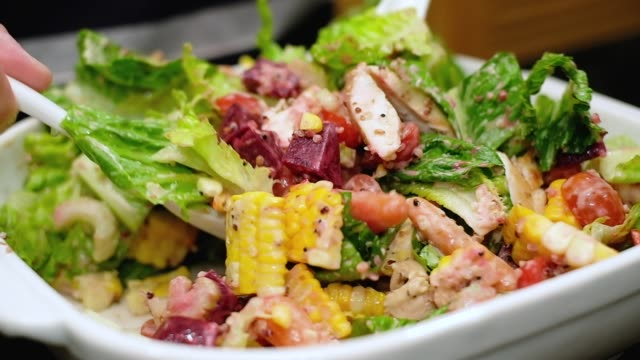 slow motion of close up  hand use mixing fresh chicken salad and dressing salad with white spoon . - quinoa salad stock videos & royalty-free footage
