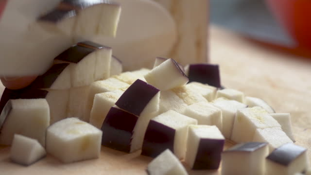 slow motion of close up of knife dicing of eggplant - aubergine stock videos & royalty-free footage