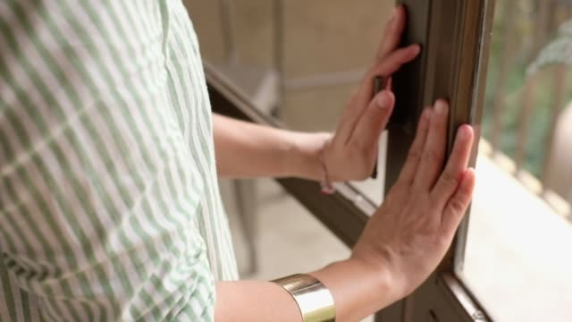 Slow motion of Close up woman hand open up door at hotel balcony.relax vacation