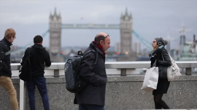 Slow motion of commuters walking over London Bridge backdropped by Tower Bridge towards the City of London UK on Tuesday Nov 7 Photographer Luke...