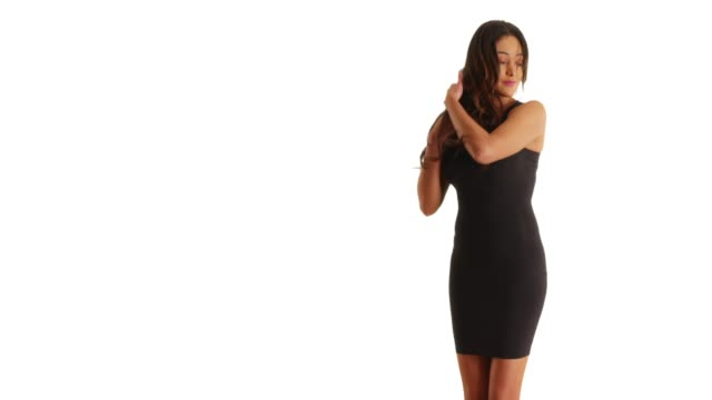 slow motion of cuban woman in tight black dress dancing sensually in studio - black dress stock videos & royalty-free footage