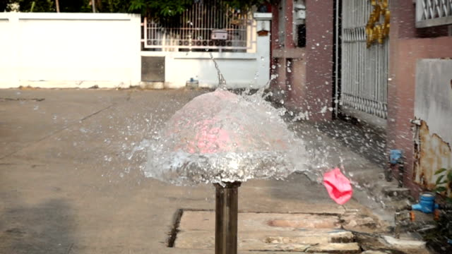 Slow Motion Of Dart Puncturing A Pink Water Balloon